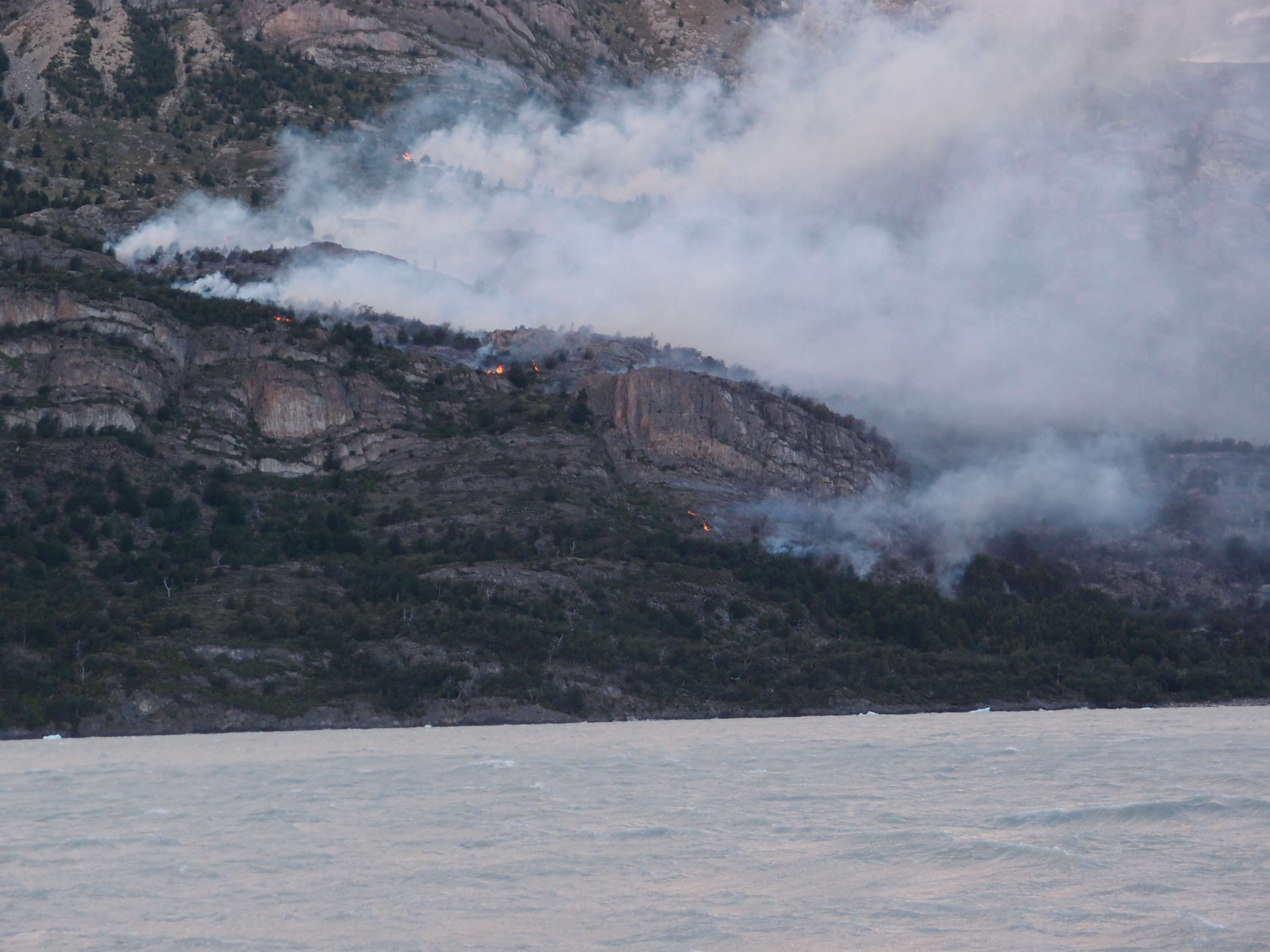Torres del Paine fire from ferry during evacuation